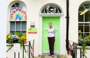 woman standing in front of lime green door